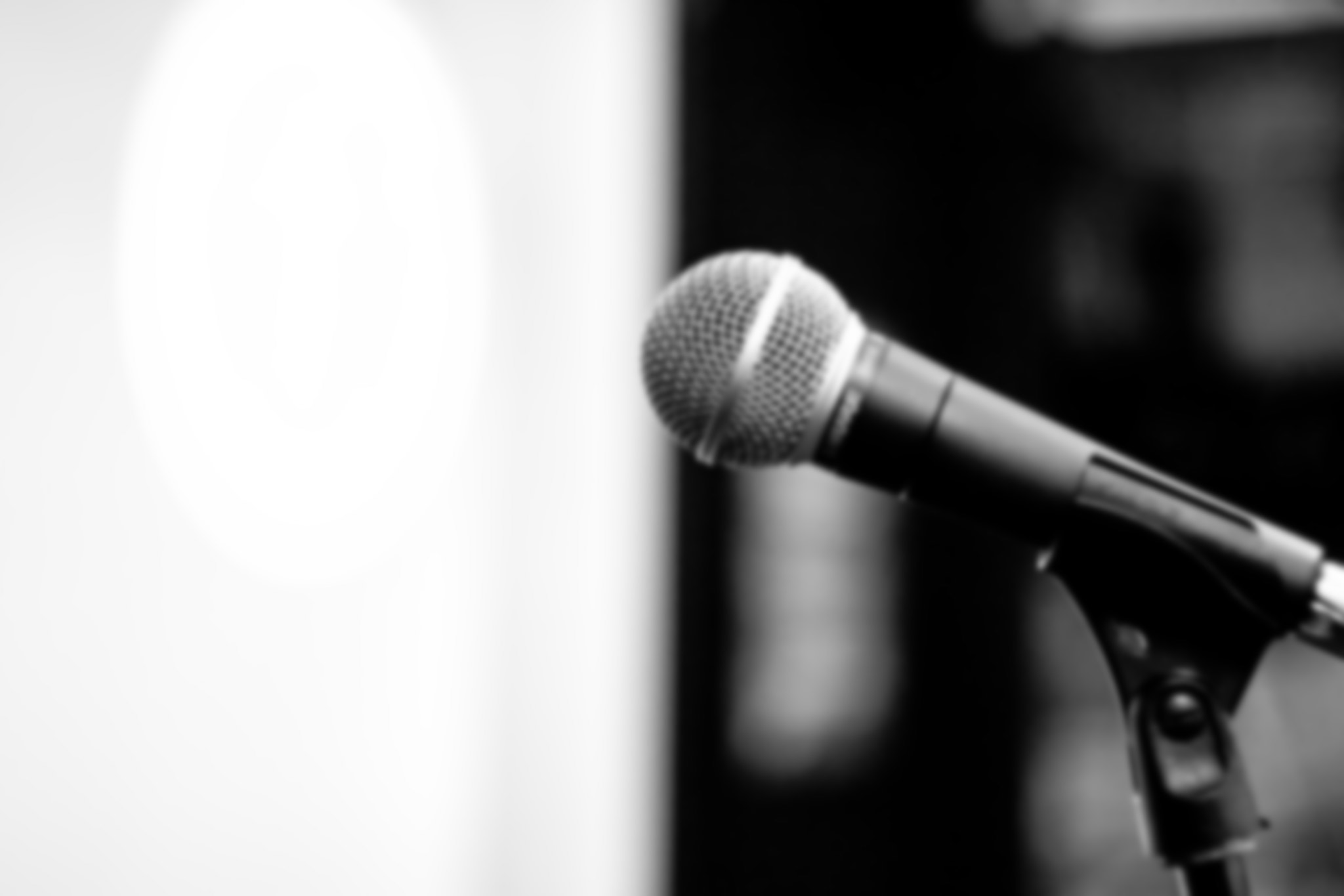 A slightly blurred microphone in black and white